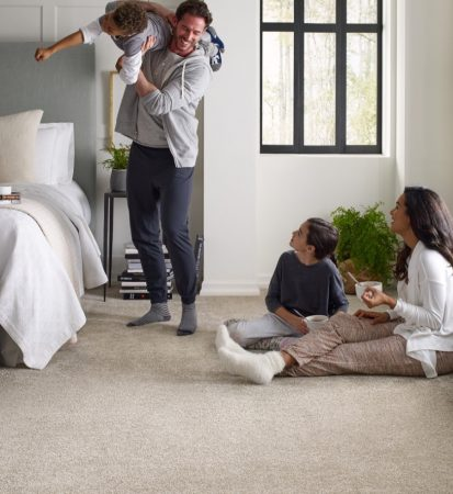 Family in bedroom with carpet | Choice Floor Center